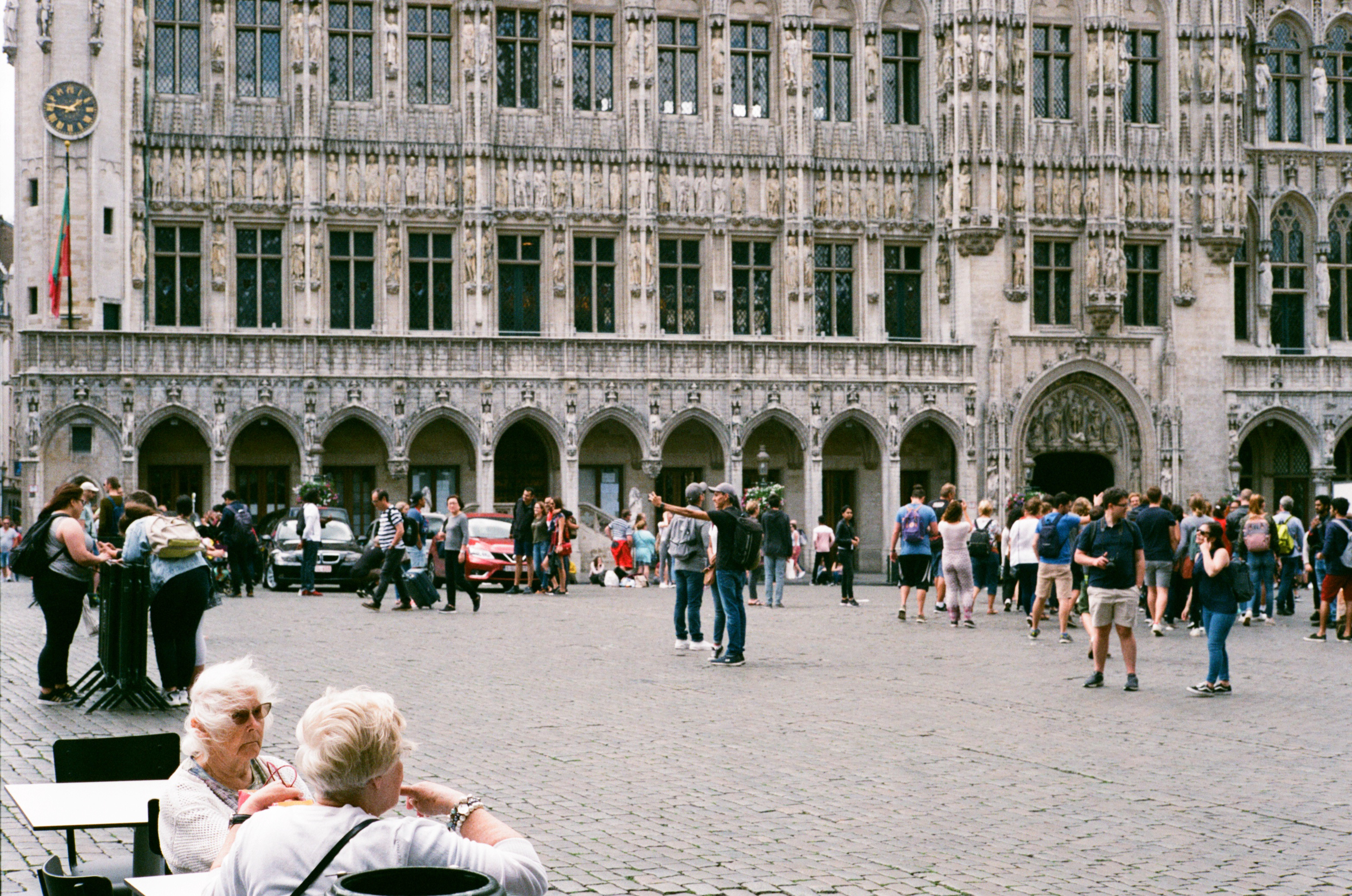 Two ladies seated in Grand Place Brussels