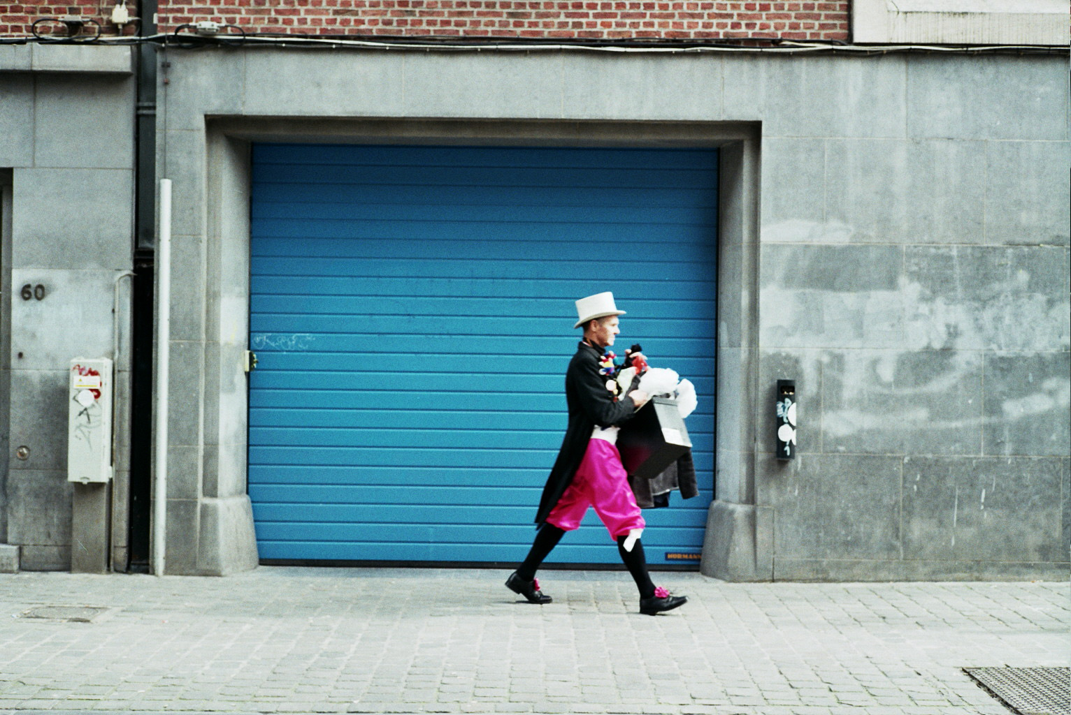 Costumed man walking to a theatre